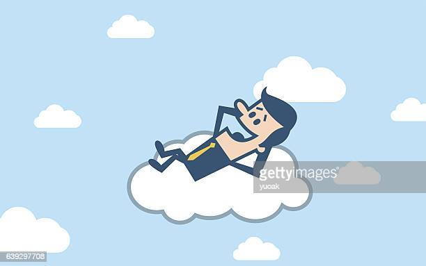 Businessman sleeping on cloud