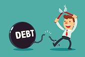 businessman use pliers to cut the chain and free himself from debt metal ball. Financial freedom concept.