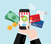 Businessman's hand shopping online by cash and credit card, Online store on smartphone with striped awning, Mobile payment