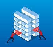 Businessmen working together to pile blocks
