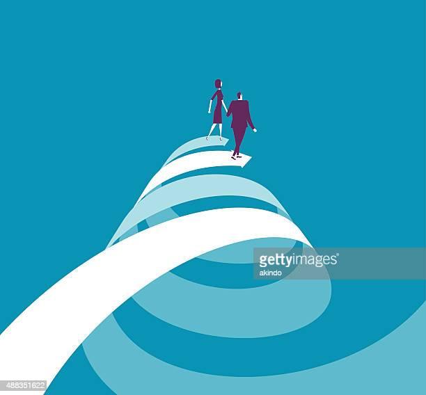 Empresaria y hombre de negocios caminando en dos flechas en espiral