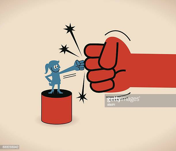Businesswoman does a fist bump with a big red fist