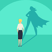 Businesswoman with superhero shadow vector concept. Business symbol of emancipation ambition and success motivation. Leadership or courage and challenge. Eps10 vector illustration.