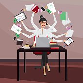 Multitasking business woman working in the workplace