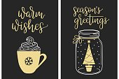 Christmas cards with modern calligraphy writing. Warm wishes and Seasons greetings lettering with cream coffee cup and Christmas tree in jar