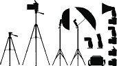 High detailed silhouettes of Cameras, Flashes, umbrellas, tripods, difusers isolated on white background.
