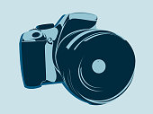 SLR camera, symbol style in blue tones on a light background