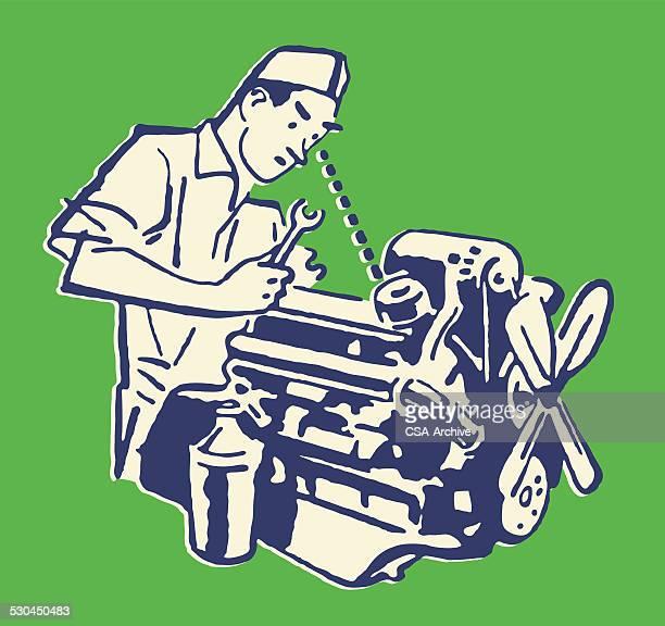 Mecánico trabajando en coche motor