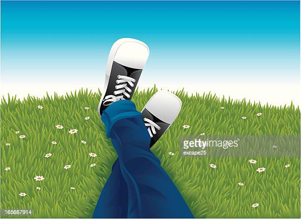 A cartoon image of someone's legs in grass