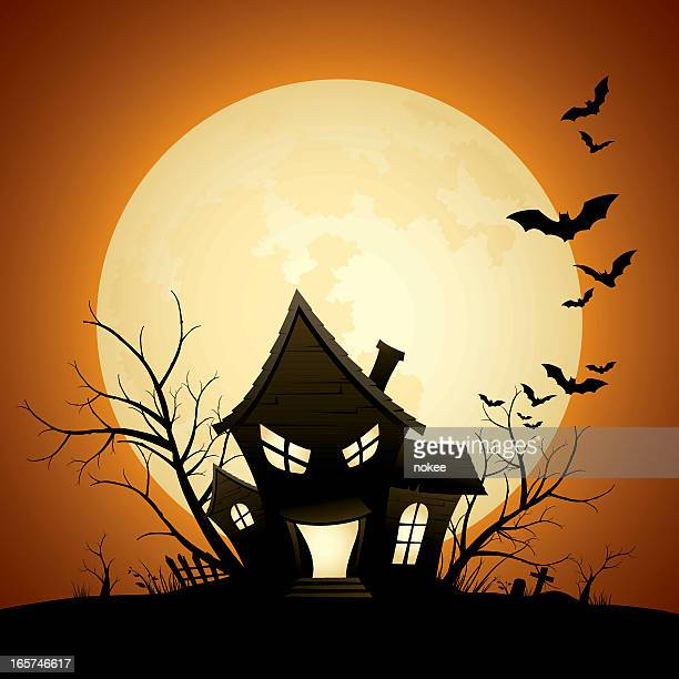 Cartoon of a silhouette of a scary haunted house with bats