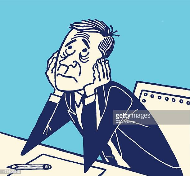 Cartoon of a worried man seated at a desk
