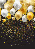 Celebration background with gold and silver balloons and confetti