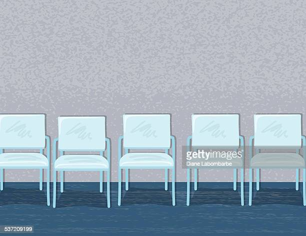 Chairs Lined Up In An Empty Waiting Room Or Office