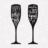 Champagne New Years lettering modern calligraphy set on champagne glass shape isolated vector typography elements. Happy new year. May it be the best year yet.
