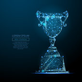 Abstract image of a champion cup in the form of a starry sky or space, consisting of points, lines, and shapes in the form of planets, stars and the universe. Vector business wireframe concept.