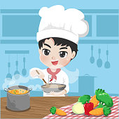Chef boy is cooking with a happy love in his kitchen.
