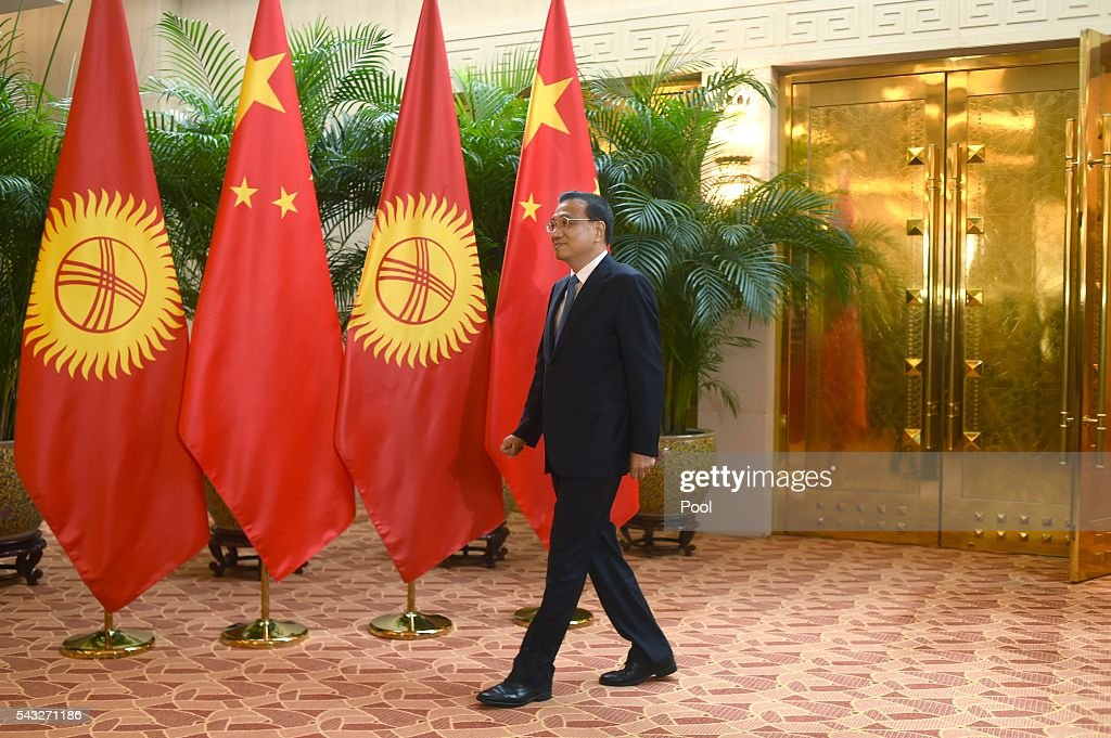 Chinese Premier <a gi-track='captionPersonalityLinkClicked' href=/galleries/search?phrase=Li+Keqiang&family=editorial&specificpeople=2481781 ng-click='$event.stopPropagation()'>Li Keqiang</a> prepares to meet Kyrgyzstan's Prime Minister Temir Sariyev (not in picture) during the World Economic Forum on June 27, 2016 in Tianjin, China. The annual World Economic Forum New Champions meeting brings together business, economic and political leaders and former officeholders.