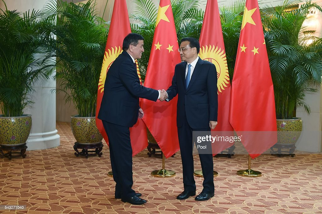Chinese Premier <a gi-track='captionPersonalityLinkClicked' href=/galleries/search?phrase=Li+Keqiang&family=editorial&specificpeople=2481781 ng-click='$event.stopPropagation()'>Li Keqiang</a> (R) shakes hands with Kyrgyzstan's Prime Minister Temir Sariyev during the World Economic Forum on June 27, 2016 in Tianjin, China. The annual World Economic Forum New Champions meeting brings together business, economic and political leaders and former officeholders.
