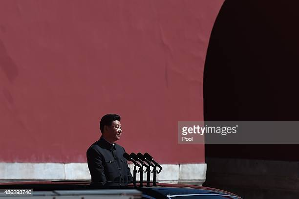 Chinese President Xi Jinping prepares to review the People's Liberation Army troops from a car during a military parade to mark the 70th anniversary...