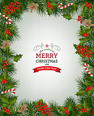 Christmas background with fir branch borders and decorative elements.Christmas border with trees, berry, and other Christmas ornaments