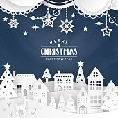 Christmas background with winter town landscape and decorations. Paper art style