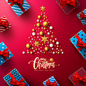 Christmas Calligraphic Inscription with Christmas tree,Christmas decoration elements and gift box on red background.Merry Christmas and happy new year concept for Christmas promotion banner template.V