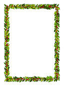 Christmas decorations with holly leaves and red berries. Vertical frame with copy space, Illustration for xmas and new year design.