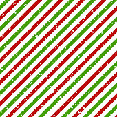 Christmas diagonal striped red and green lines on white background with snow texture, Vector illustration