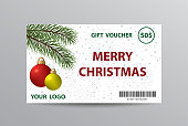 Christmas gift voucher with hanging balls and Christmas tree branches.