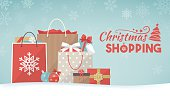 Colorful christmas gifts, shopping bags and decorations on the snow, xmas shopping concept banner