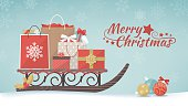 Colorful christmas gifts and shopping bags on a traditional wooden sleigh, xmas shopping and celebration concept banner