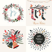 A collection of four Christmas greeting cards with seasonal design