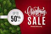 Christmas holiday sale 50% off with paper sticker on red background with fir tree branches. Limited time only. Template for a banner, poster, shopping, discount, invitation. Vector illustration for yo
