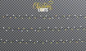 Christmas lights. Realistic string lights design elements of white and yellow colors. Glowing lights for winter holidays. Shiny garlands for Xmas and New Year.