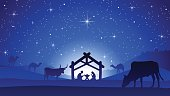 A nice illustration of the Birth of Jesus Christ in a manger with Mary and Joseph. Camels and cows surrounding the area.