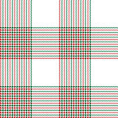 Christmas plaid pixel pattern in red, green, and white. Seamless tartan check plaid for poncho, tablecloth, coat, or other textile design.