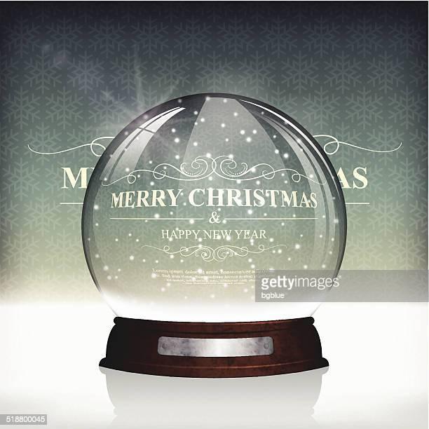 Christmas snow globe on Vintage Background