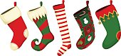 Vector illustration of a variety of Christmas stockings. Each stocking is on its own layer, easily separated from the other stockings.  Illustration uses no gradients, meshes or blends of any kind. Bo