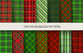 Christmas tartan seamless patterns in grin and red colors. Vector illustration