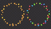 Christmas festive decorations, yellow and colored translucent fairy lights ring shaped. Isolated on transparent background. Transparency only in vector file