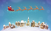 Christmas, vector. Santa Claus rides in sleigh pulled by reindeer over city