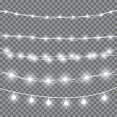 Christmas light garland. Realistic glowing white light bulbs on wires. Decoration for xmas or party, wedding. Design element for postcard or advertise.