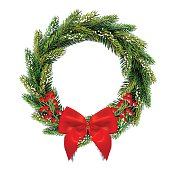 Christmas wreath with bow and red berries. Isolated on white background.