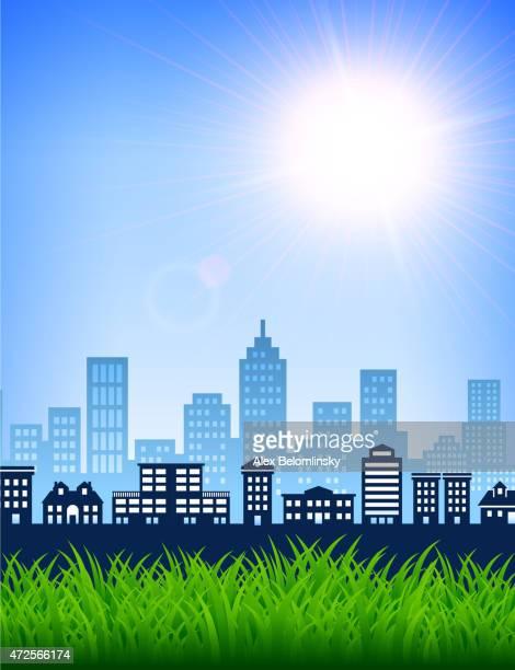 Ville Skyline journée d'été avec un ciel bleu et fond herbe