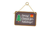 Hanging sign with text and Christmas images