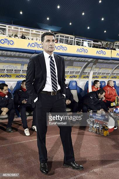 Coach of Olympiakos Michel Gonzalez looks on during the Greek Superleague match between Atromitos Athinon and Olympiacos at the Peristeri Stadium on...