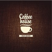 vector banner with a cup of coffee on a background fabric texture