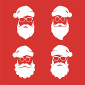 Collection of four vector hipster style Santa Claus silhouettes.