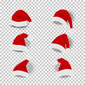 Collection of red santa hats on transparent background.