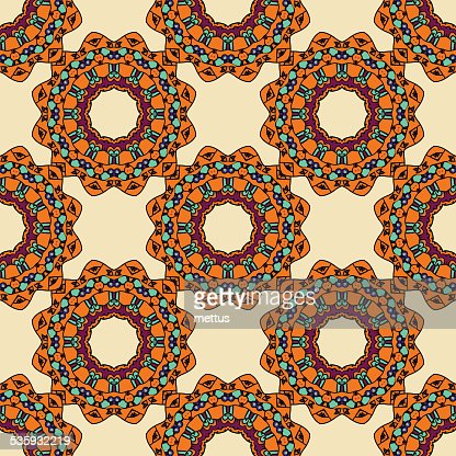 Colorful circle flower mandalas seamless pattern in pink and green : Vector Art